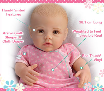 This lifelike So Truly Mine doll from The Ashton-Drake Galleries is crafted with RealTouch vinyl, has hand-painted features, arrives with a sleeper and cloth diaper, is weighted to feel incredibly real and is 38.1 centimetres long.